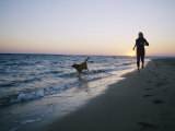 Woman and Dog Running on Beach  Nags Head  North Carolina