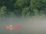 Man Paddling Canoe in Mist  Roanoke River  North Carolina