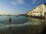 A Beach Goer Wades into the Calm Surf of Cadaques