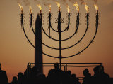 Silhouetted Worshippers Stand Before a Large Menorah Near the Washington Monument