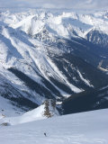 A Back-Country Snowboarder Descends a Snowfield Near Rogers Pass