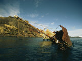 A Partially Submerged Shipwreck Along a Rocky Shore