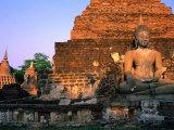 Serene Buddha and Ancient Ruins at Wat Mahathat  Sukhothai Historical Park  Sukhothai  Thailand