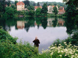 Man Fishing in Lake in In Oliwa  Gdansk  Poland