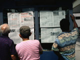 Men Reading the Daily Newspaper at an Inner City Kiosk  Havana  Cuba