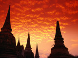 Sun Sets Over the Chedis (Buddhist Stupas) of Wat Phra Si Sanphet  Ayuthaya  Thailand