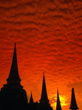 Brilliant Sunset Clouds Blanket the Sky Over the Chedis of Wat Phra Si Sanphet  Thailand