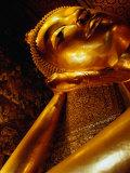 Detail of Reclining Buddha's Head at Wat Pho  Bangkok  Thailand