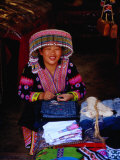 Hmong Village Woman Wearing a Tribal Hat at a Cloth Stall  Chiang Mai  Thailand