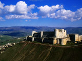 Castle on Hilltop Overlooking Village  Crac Des Chevaliers  Syria