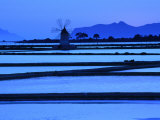 Windmill and Surrounding Saltpans on the Island of San Pantaleo  Sicily  Italy