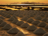 Sun Setting Over Mounds of Salt Drying on Saltpans  Mothia  San Pantaleo  Sicily  Italy
