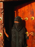 Woman in Bui-Bui Standing in Zanzibar Doorway  Looking at Camera  Lamu  Kenya