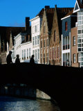 Pedestrians Crossing Canal and Houses Near Jan Van Eyckplein  Bruges  Belgium