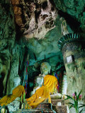 Seated Buddha Statues in Saffron Cloth Inside Cave  Chiang Dao  Thailand