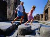 Mother and Daughter Crossing Ancient Street  Pompeii  Italy