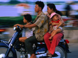 Young Family on Motorcycle  Phnom Penh  Cambodia