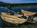 Aymara Boy on Reed Boat on Lake  Lake Titicaca  Puno  Peru