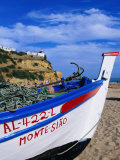 Traditional Painted Fishing Boat on Beach  Albufeira  Algarve  Portugal