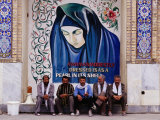 A Group of Men Sitting in Front of a Mural in the Courtyard of the Tomb of Prophet Daniel  Iran