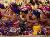 Children and Adults in Traditional Costume Praying at Pura Penataran Agung  Pura Besakih  Indonesia