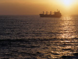 Cargo Ship at Sea Silhouetted at Sunset  Chile
