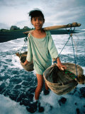 A Girl Gathers Salt Water in Lontar Leaf Buckets for Salt Making  Kusamba  Indonesia