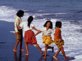 Girls on Lebih Beach  South of Gianyar  Play along the Fringe of Breaking Waves  Indonesia