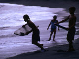 Young Surfers on Black-Sand Beach  French Polynesia
