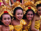 Smiling Faces on Four Young Girls All Dressed Up for a Temple Procession  Indonesia
