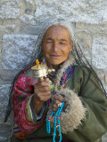 Tibetan Woman Holding Praying Wheel in Sakya Monastery  Tibet  China