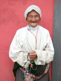 Elderly Tibetan Woman with Red Wall  Tagong  Sichuan  China
