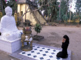 Woman Praying to Buddha  Vinh Trang Pagoda  My Tho City  Vietnam