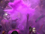 People Painted with Bright Colors Dance During the Festival of Holi on March 7  2004