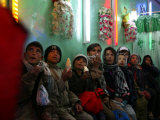 Afghan Boys Watch a Movie on a Television  Unseen  as They Eat Ice Cream at an Ice Cream Shop