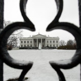 A Light Dusting of Snow Covers the Ground in Front of the White House