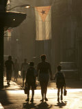 A Mother Walks Her Children to School in Old Havana  Cuba