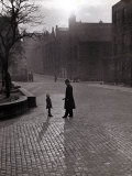 Policeman Talking to Lost Child on a Cobbled Street in Edinburgh  Scotland