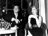 Marilyn Monroe Drinking a Cup of Tea as She Sits with Laurence Olivier Smoking a Cigarette  1956
