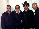 Members of U2 the Edge  Adam Clayton Larry Mullen and Bono Attending the MTV Awards Rotterdam 1997