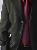 Businessman Wearing Red Shirt and Tie Under Black Suit