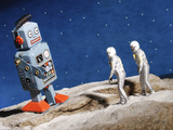 Astronaut Figurines Standing Beside Gray Toy Rocket