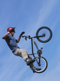 Man Performing Trick on a Bicycle