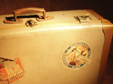 Brown Antique Suitcase Covered in Travel Stickers