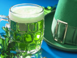 Mug of Green Beer Beside Green St Patrick&#39;s Day Decorations