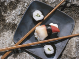 Sushi and Chopsticks Beside Rushing Water