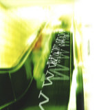 Green and Yellow Escalator Moving Www Upwards
