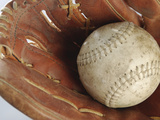 Beaten-Up Baseball in Baseball Glove