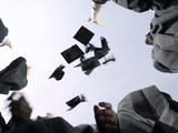 Graduates Throwing Hats Up in the Air