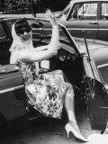 Girl in a Flower Print Dress  High Heels  Headscarf and Sunglasses Steps out of a Convertible Car